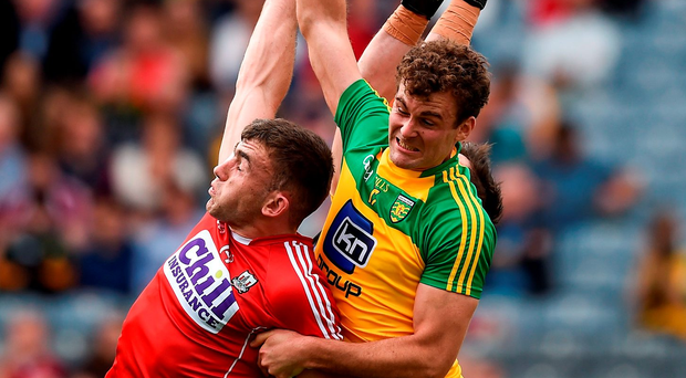 Cork's Peter Kelleher in an aerial battle with Donegal pair Eamonn McGee and Mark Anthony McGinley in Croke Park on Saturday. Photo: Ray McManus/Sportsfile