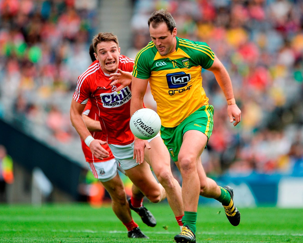 Donegal's Michael Murphy of Donegal in action against Cork's Aidan Walsh. Photo: Daire Brennan/Sportsfile