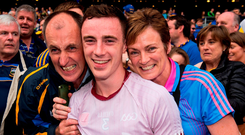 Tipperary full-back Alan Campbell with his parents, Tommy and Patty, after the Premier County's win over Galway. Photo: Ray McManus/Sportsfile