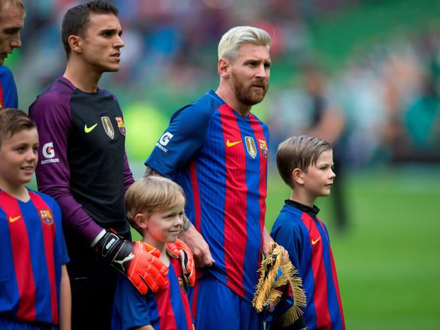 Messi, with his new blond hairdo. Picture by Fergal Phillips