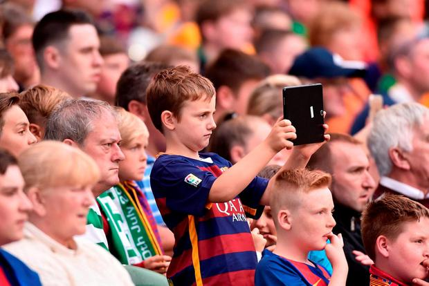 A young fan takes a selfie. Photo by David Maher/Sportsfile