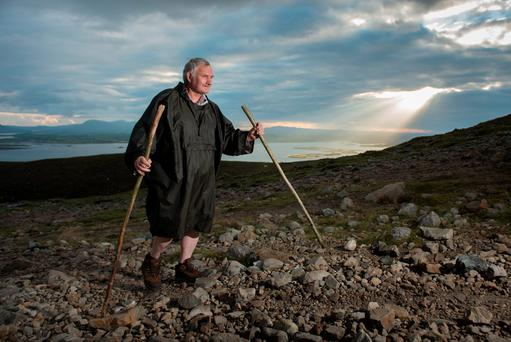 Pilgrim Eugene Bevans from Birr, Co Offaly, climbs the reek. Pic: Michael McLaughlin