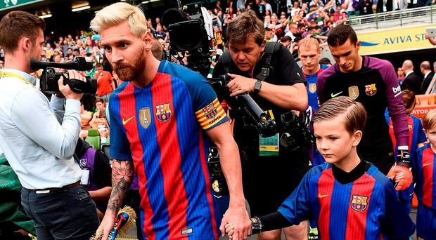 Lionel Messi of FC Barcelona lead out the FC Barcelona team during the International Champions Cup match between Glasgow Celtic and Barcelona at the Aviva Stadium in Dublin. Photo by David Maher/Sportsfile