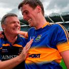 Tipperary's Conor Sweeney celebrates with manager Liam Kearns and (left) Sweeney with Michael Quinlivan