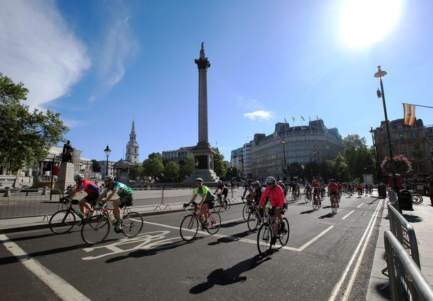 Cyclists pass Trafalgar Square in London in the early stages on the Prudential Ride 100. Credit: Jonathan Brady/PA Wire