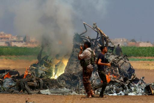 Men inspect the wreckage of a Russian helicopter that had been shot down in the north of Syria's rebel-held Idlib province, Syria August 1, 2016. REUTERS/Ammar Abdullah