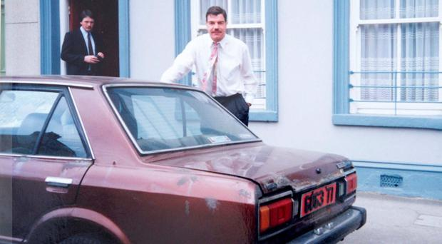 Sam Allardyce and his then assistant Bill Kinnane with his modest transport during his time in Limerick. Photo: Limerick Leader