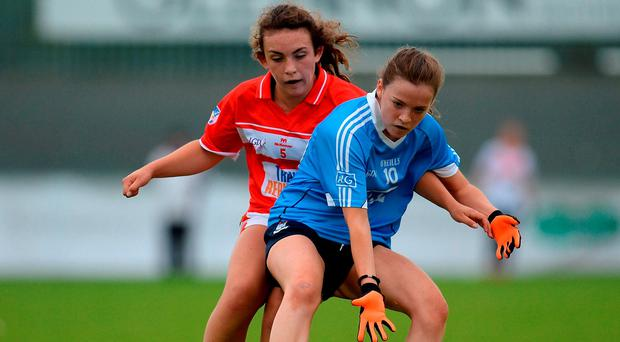 Mia Jennings of Dublin in action against Ciara Hughes of Cork. Photo: Seb Daly/Sportsfile