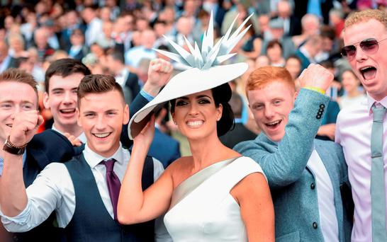 Lisa McGowan, from Tullamore, Co Offaly, who was named best dressed lady, pictured with racegoers at the Galway Races in Ballybrit, Co Galway. Photo by Cody Glenn/Sportsfile