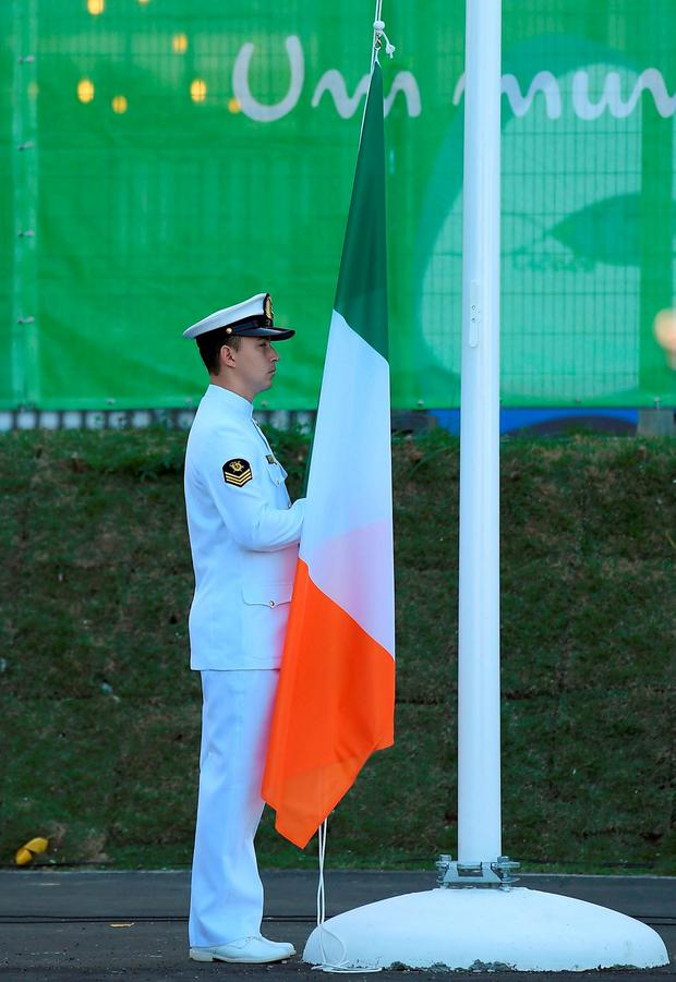 The Irish tricolour is prepared to be raised during the team's welcome ceremony in the Olympic Village. Photo by Brendan Moran/Sportsfile
