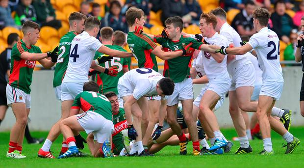 A melee breaks out between Kildare and Mayo players during yesterday's MFC quarter-final in Tullamore. Photo: Adrian Melia