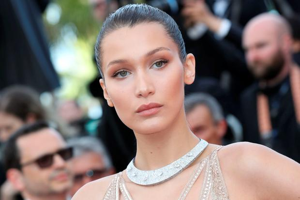 US model Bella Hadid poses as she arrives on May 11, 2016 for the opening ceremony of the 69th Cannes Film Festival in Cannes, southern France. / AFP / Valery HACHE (Photo credit should read VALERY HACHE/AFP/Getty Images)