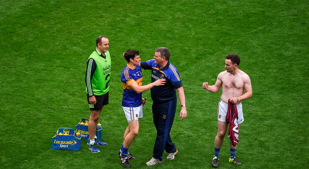 Tipperary manager Liam Kearns celebrates with Ciarán McDonald