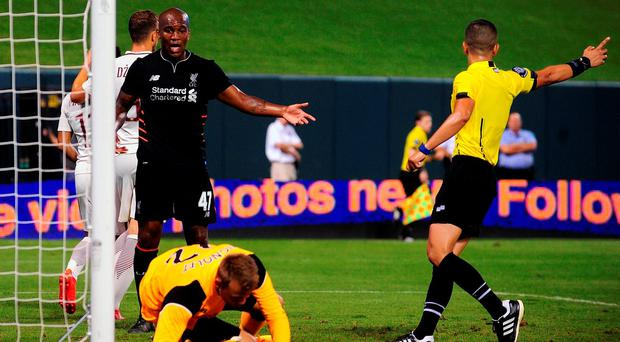 Andre Wisdom of Liverpool reacts after Simon Mignolet's blunder against Roma