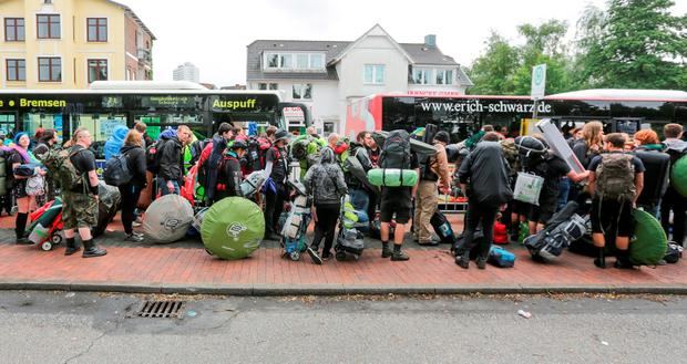 Organizers say rucksacks and heavy bags are banned from the main festival grounds due to security. (Axel Heimken/dpa via AP, file)