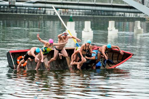 Eager swimmers Colm Kinsella sisters Aine and Yvonne McCarthy ,Hugo Camancho-Romero,Niall Rafferty,Kai Griffin-English jump into the Liffey from David Kelly's Curragh