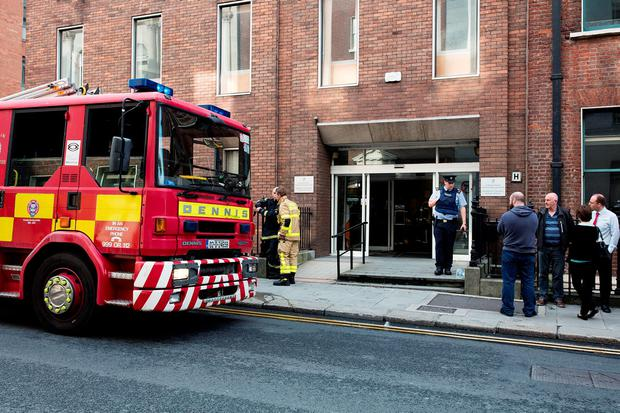 2/8/16 Dublin fire brigade tend to a fire at the Department of Transport on Kildare street in Dublin. Pictures:Arthur Carron