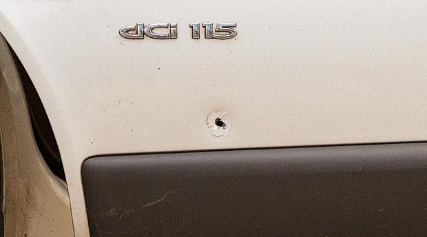 A bullet hole in the van which was attacked by the gunmen