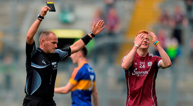 Galway's Adrian Varley reacts after he is shown a black card by referee Conor Lane during Sunday's All-Ireland SFC quarter-final at Croke Park. Photo: Sportsfile