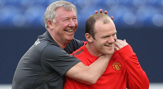 Alex Ferguson says players like Wayne Rooney deserve the huge wages they take home