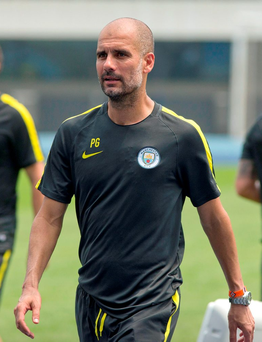 Pep Guardiola: fewer nights in hotels. Photo: AP