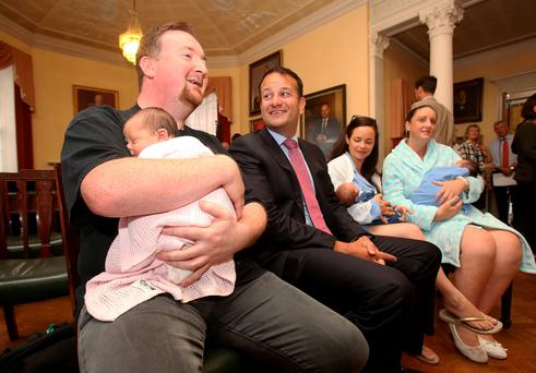 Minister Leo Varadkar TD with, from left, Chris Cassidy from Armagh with his two-day-old son Robyn, and Treasa Scott from Castleknock with her five-day-old son Dan. Pic Tom Burke