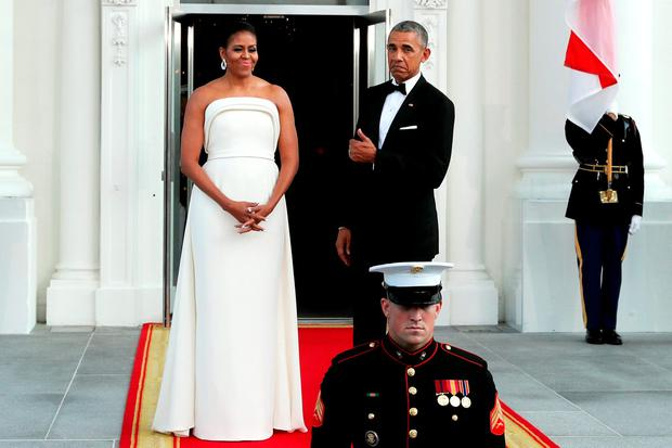 U.S. first lady Michelle Obama and U.S. President Barack Obama wait for the arrival of Prime Minister Lee Hsien Loong of Singapore and his wife Ho Ching on the North Portico of the White House