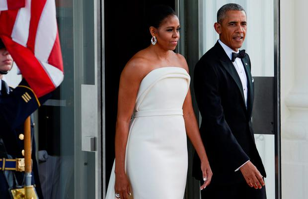 President Obama and the First Lady Michelle Obama await the arrival of Prime Minister Lee Hsien Loong and Madam Ho Ching at the North Portico of the White House