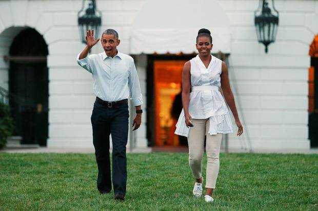June 2015: U.S. President Barack Obama and first lady Michelle Obama walk out of the White House while hosting Girl Scouts from across the country for a campout on the South Lawn.