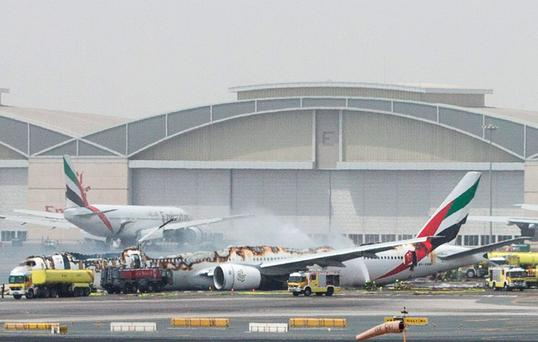 An Emirates Airline flight is seen after it crash-landed at Dubai International Airport, the UAE August 3, 2016