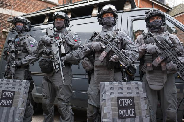 Armed police prepare to deploy from Hyde Park.
