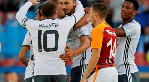 Manchester United's Zlatan Ibrahimovic celebrates with Wayne Rooney and team mates after scoring their first goal against Galatasaray. Action Images via Reuters / Henry Browne