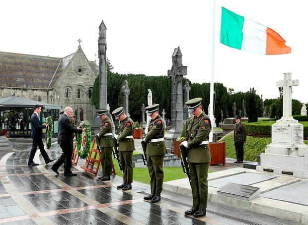 Niall Casement and Foreign Affairs Minister Charlie Flanagan lay wreaths at the ceremony to honour Roger Casement in Glasnevin cemetery. Photo: Gerry Mooney