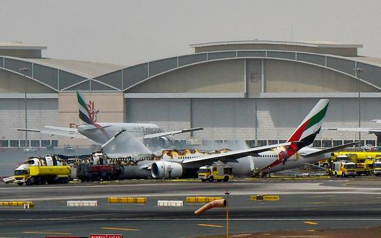 A picture shows a Boing 777 of the UAE airliner Emirates after it caught fire following a crash-landing at Dubai airport on August 3, 2016. Photo: Ahmed Ramzan/AFP Photo/Getty Images/Gulf News Dubai