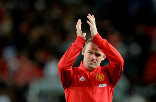 Manchester United's Wayne Rooney applauds the fans at the end of his testimonial at Old Trafford. Getty Images