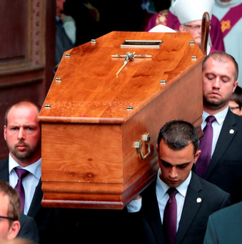 Pallbearers carry the coffin of Fr Jacques Hamel, the 85-year-old priest murdered by jihadists near Rouen, France, last week Photo: JOEL SAGET/AFP/Getty Images