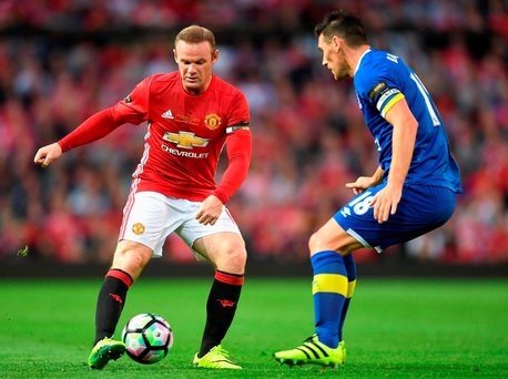 Wayne Rooney of Manchester United takes on Gareth Barry of Everton during his Testimonial match between (Photo by Michael Regan/Getty Images)