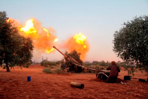 Rebel Ajnad Al-Sham fighters fire shells towards regime positions near Aleppo, Syria Photo: OMAR HAJ KADOUR/AFP/Getty Images