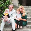 Karen Koster and John McGuire with sons Finn and John. Picture: Lili Forberg/VIP Magazine