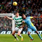 Celtic's Eoghan O'Connell and Astana's Patrick Twumasi during the UEFA Champions League, Third Qualifying Round, Second Leg match at Celtic Park last night