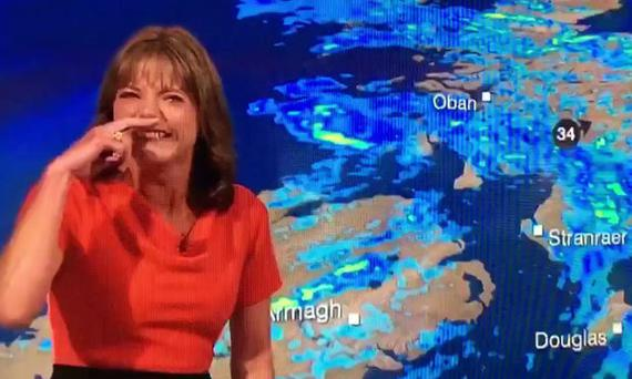 BBC weather presenter Louise Lear bursts into a fit of giggles live on air
