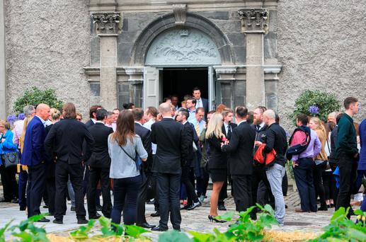 Mourners during a celebration of Publican Oliver Hughes's life at the Royal Hospital Kilmainham, Dublin. Photo: Gareth Chaney Collins