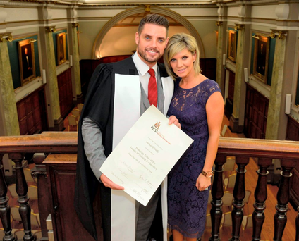 Keith Duffy (with his wife Lisa) was awarded an honorary fellowship for autism work by RCS. Photo: Ray Lohan/ RCSI