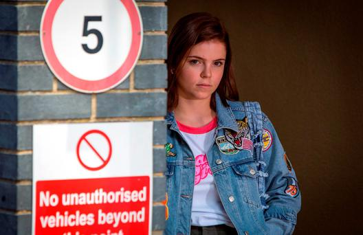 Courtney, played by Alice Nokes, loitering outside the police station waiting for Grant. Photo: Jack Barnes/BBC/PA Wire