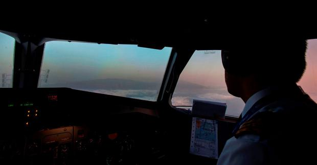 A cockpit view as pilots fly shows dark clouds of smoke from a wildfire near the town of Mazo spreading out across the horizon on the Spanish canary island of La Palma on August 4, 2016