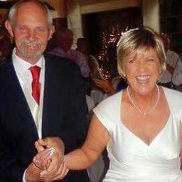 Anne Herlihy pictured with her husband TJ at the renewal of her vows last year