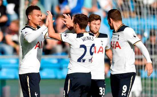 Tottenham's Dele Alli celebrates with team mates after scoring their third goal Action Images via Reuters / Adam Holt