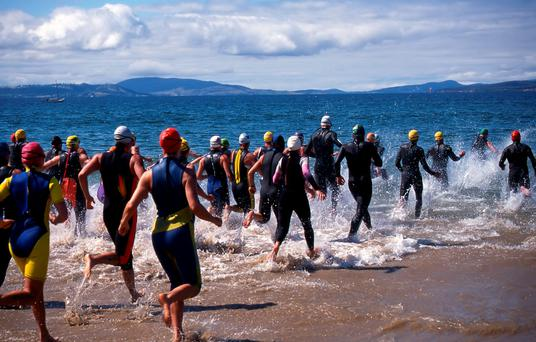 Competitors in Triathlon entering the water for the swimming leg