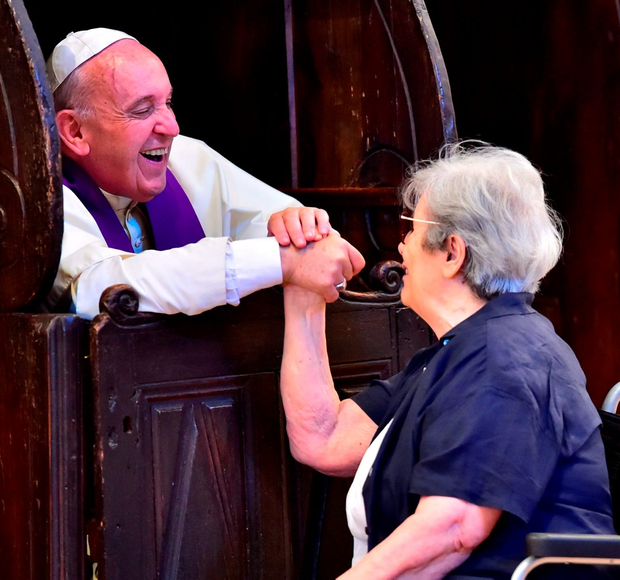 Pope Francis speaks to a woman during confession at the Porziuncola (Portiuncula) at Santa Maria degli Angeli Basilica, near Assisi in Italy. Photo: Getty