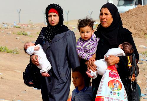Iraq refugees fleeing from Mosul Isil some time ago amid reports that some 3,000 refugees have been captured by the terror group. Photo: AP Photo